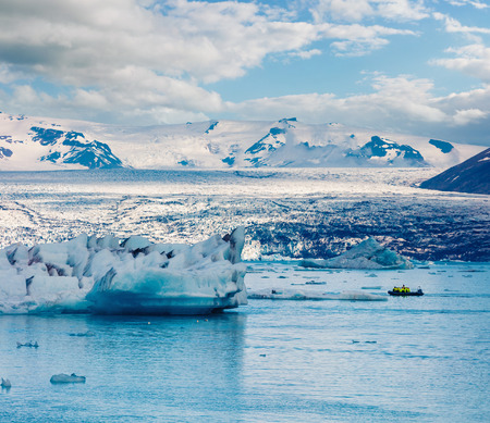 View of floating of blue icebergs in Jokulsarlon glacial lagoon. Boat excursion in Vatnajokull National Park, southeast Iceland, Europe. Artistic style post processed photo.