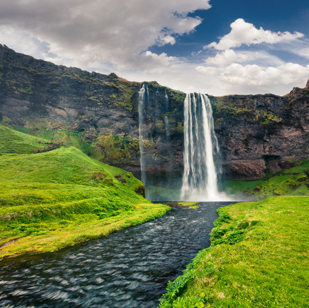 Beautiful morning view of Seljalandfoss Waterfall on Seljalandsa river. Colorful summer scene on south coast of Iceland, Europe. Artistic style post processed photo.