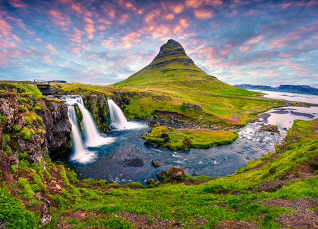 Summer sunset on famous Kirkjufellsfoss Waterfall and Kirkjufell mountain. Colorful evening scene on Snaefellsnes peninsula, Iceland, Europe. Artistic style post processed photo.