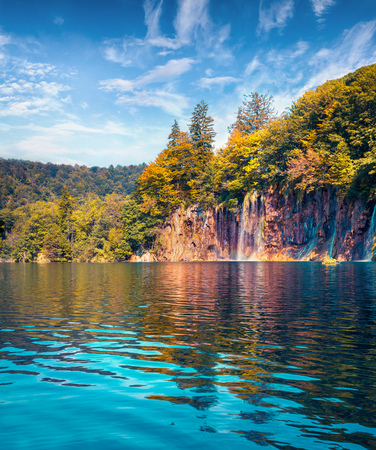 Sunny summer scene in Plitvice Lakes National Park. Pure water waterfalls flowing in azure river. Beauty of nature concept background. Croatia, Europe. Beauty of nature concept background.