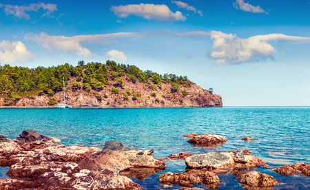 Picturesque Mediterranean seascape in Turkey. Bright view of a small azure bay near the Tekirova village, District of Kemer, Antalya Province. Beauty of nature concept background. Stok Fotoğraf - 93250731