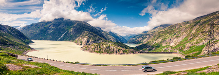 Sunny morning panorama of the coast of Grimselsee reservoir on the top of Grimselpass. Colorful summer in Swiss Alps,  canton of Bern in Switzerland, Europe. Artistic style post processed photo.  Stock Photo