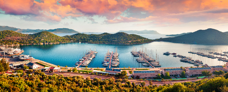 View from the birds eye of the Kas city, district of Antalya Province of Turkey, Asia. Colorful spring panorama of small Mediterranean yachting and tourist town. Artistic style post processed photo.
