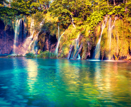 Sunny summer scene in Plitvice Lakes National Park. Pure water waterfalls flowing in azure river. Beauty of nature concept background. Croatia, Europe. Artistic style post processed photo.