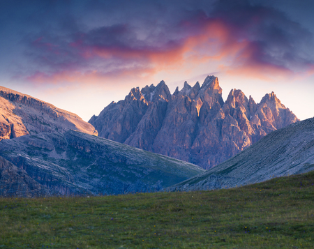 Unreal mountin peaks in the Tre Cime Di Lavaredo National Park at sunrise. Colorful summer morning in Dolomite Alps, Italy, Europe. Beauty of nature concept background.