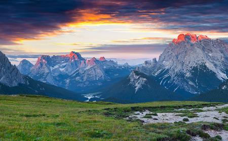 Great summer view of Gruppo Del Cristallo mountain range. Dramatic morning scene in the Tre Cime di Lavaredo National Park, Dolomite Alps, Italy, Europe. Beauty of nature concept background.