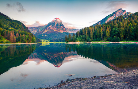 Colorful summer landscape on the Obersee lake. Splendid morning view of Swiss Alps, Nafels village location, Switzerland, Europe. Artistic style post processed photo.
