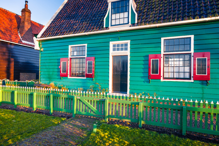 Sunny spring scene in Zaanse Schans. Beautiful morning view of typical Dutch building, Zaandam village location, Netherlands, Europe. Beauty of countryside concept background. Stock Photo