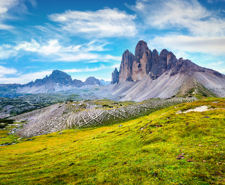 Amazing summer view of mountain peaks in Itaian Alps. Picturesque morning scene in Tre Cime Di Lavaredo National Park, Dolomite Mountains, Italy, Europe. Beauty of nature concept background.  Stock Photo