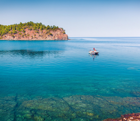 Splendid Mediterranean seascape in Turkey. Sunny view of a small azure bay near the Tekirova village, District of Kemer, Antalya Province. Beauty of nature concept background. Stok Fotoğraf - 93252953