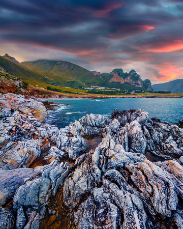 Dramatic spring sunrise on the nature reserve Monte Cofano. Colorful morning scene on the Mediterranean sea, San Vito cape location. Sicily, Italy, Europe. Beauty of nature concept background.