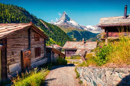 Sunny summer morning in Zermatt village with Matterhorn (Monte Cervino, Mont Cervin) peak on backgroud. Beautiful outdoor scene in  Swiss Alps, Valais canton, Switzerland, Europe.