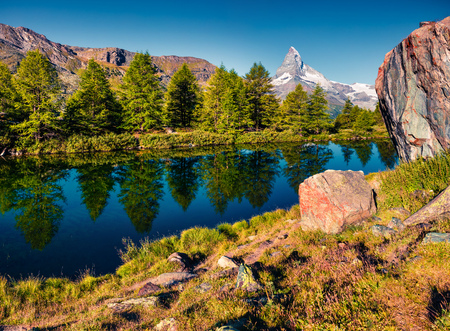 Colorful summer morning on the Grindjisee lake. Great view of  Matterhorn (Monte Cervino, Mont Cervin) peak, Swiss Alps, Zermatt location, Valais canton, Switzerland, Europe. Beauty of nature concept background. Stock Photo