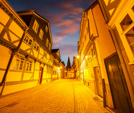 Colorful evening scene in the Wolfenbuttel village. Facade of the authentic fahverk houses. Wolfenbuttel, Germany, Europe. Artistic style post processed photo.