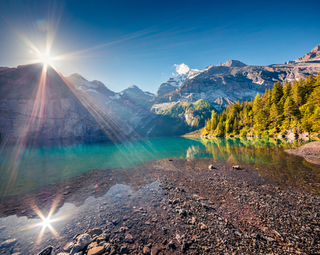 Splendid summer sunrise on the unique Oeschinensee Lake. Splendid morning scene in the Swiss Alps with Bluemlisalp mountain, Kandersteg village location, Switzerland, Europe.