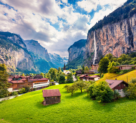 Sunny summer view of great waterfall in Lauterbrunnen village. Splendid outdoor scene in Swiss Alps, Bernese Oberland in the canton of Bern, Switzerland, Europe. Beauty of countryside concept background.