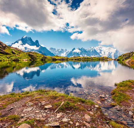 Splendid summer view of the Lac Blanc lake with Mont Blanc (Monte Bianco) on background, Chamonix location. Beautiful outdoor scene in Vallon de Berard Nature Preserve, Graian Alps, France, Europe.  Фото со стока