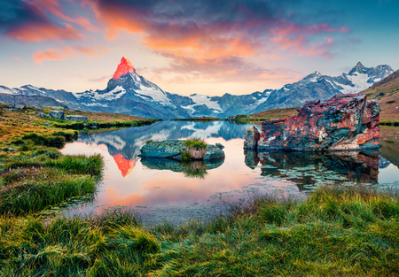 Colorful summer sunrise on the Stellisee lake. Splendid outdoor scene with Matterhorn (Monte Cervino, Mont Cervin) in Swiss Alps, Switzerland, Europe. Beauty of nature concept background.