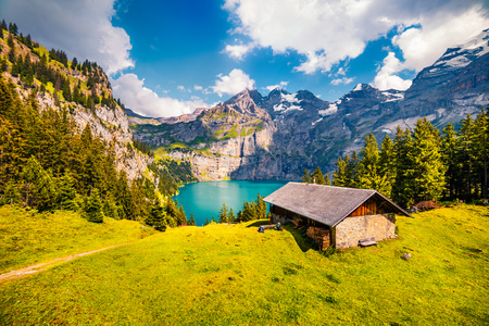 Colorful summer morning on the unique Oeschinensee Lake. Splendid outdoor scene in the Swiss Alps with Bluemlisalp mountain, Kandersteg village location, Switzerland, Europe.