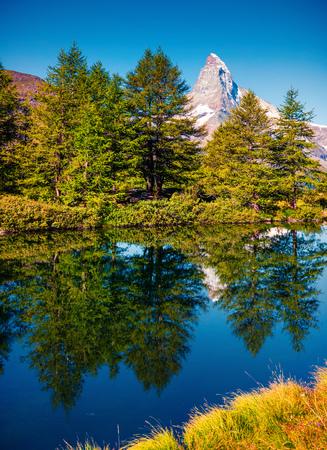 Picturesque summer morning on the Grindjisee lake. Great view of  Matterhorn (Monte Cervino, Mont Cervin) peak, Swiss Alps, Zermatt location, Valais canton, Switzerland, Europe. Beauty of nature concept background.