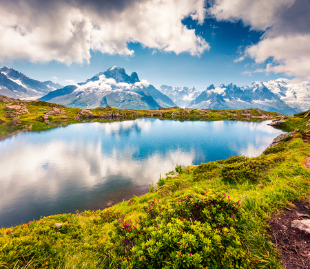 Colorful summer view of the Lac Blanc lake with Mont Blanc (Monte Bianco) on background, Chamonix location. Beautiful outdoor scene in Vallon de Berard Nature Preserve, Graian Alps, France, Europe.