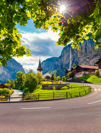 Sunny summer view of great waterfall in Lauterbrunnen village. Splendid outdoor scene in Swiss Alps, Bernese Oberland in the canton of Bern, Switzerland, Europe. Artistic style post processed photo. Stock Photo