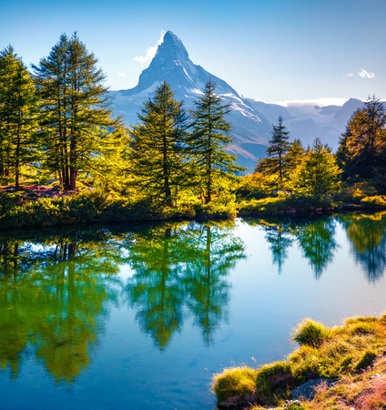 Sunny summer morning on the Grindjisee lake. Splendid view of  Matterhorn (Monte Cervino, Mont Cervin) peak, Swiss Alps, Zermatt location, Valais canton, Switzerland, Europe. Beauty of nature concept background.