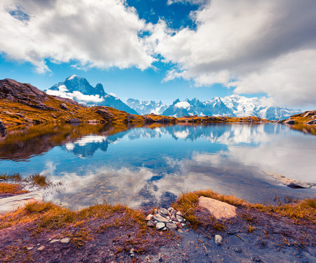 Colorful autumn view of the Lac Blanc lake with Mont Blanc (Monte Bianco) on background, Chamonix location. Beautiful outdoor scene in Vallon de Berard Nature Preserve, Graian Alps, France, Europe.  Imagens