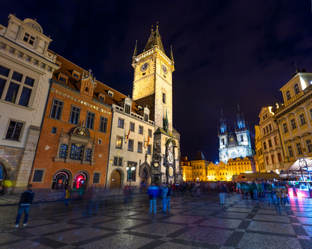 Thousands of tourists walking in spring night on the Old Town square with Tyn Church. Colorful sityscape in capital of Czech Republic - Prague, Europe. Artistic style post processed photo.