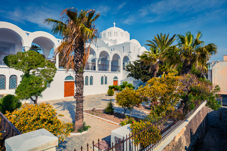 Beautiful spring view of garden at Fira Orthodox Cathedral. Colorful morning scene of the famous Greek resort - Fira, Santorini, Greece, Europe.