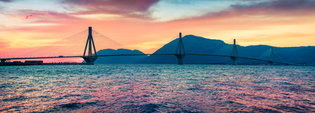 Dramatic evening sunset with Rion-Antirion Bridge. Colorful spring panorama of the Gulf of Corinth, Greece, Europe. Reklamní fotografie