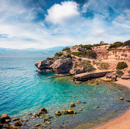 Sunny spring view of West Court of Heraion of Perachora, Limni Vouliagmenis location. Colorful morning seascape of Aegean sea, Greece, Europe.