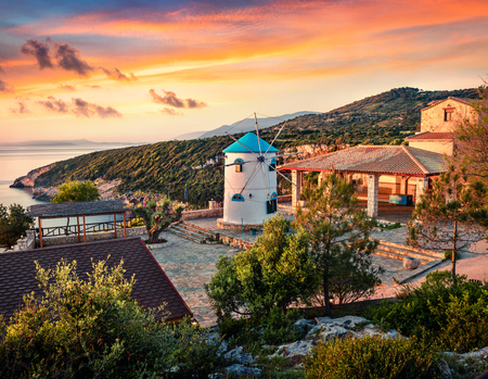 Fabulous morning scene of the contryside with Windmill. Colorful spring sunrise on the Zakynthos island, Korithi location, Ionian Sea, Greece, Europe.