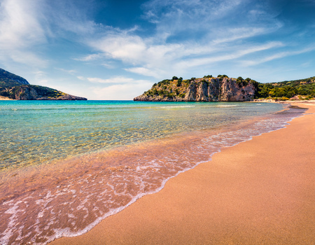 Colorful spring view of Voidokilia beach. Bright morning scene on the Ionian Sea, Pilos town location, Greece, Europe. Stock Photo