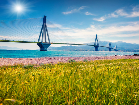 Sunny morning scene of Rion-Antirion Bridge. Colorful spring view of the Gulf of Corinth, Greece, Europe.