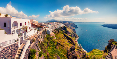 Sunny morning panorama of Santorini island. Great spring view of the famous Greek resort Fira, Greece, Europe. Stock Photo
