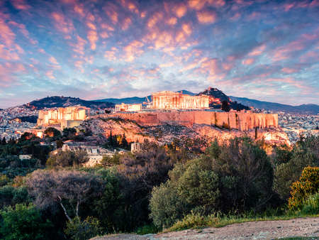 Great spring view of Parthenon, former temple, on the Athenian Acropolis, Greece, Europe. Colorful sunset in Athens.