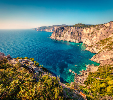 Aerial spring view of high cliffs on the Ionian Sea. Sunny morning seascape of Zakynthos (Zante) island, Greece, Europe.