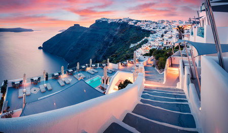 Great evening view of Santorini island. Picturesque spring sunset on the famous Greek resort Fira, Greece, Europe.