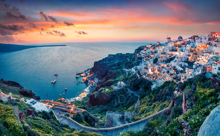 Impressive evening view of Santorini island. Picturesque spring sunset on the famous Greek resort Oia, Greece, Europe.