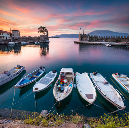 Colorful spring view of the Nafpaktos port. Fantastic sunrise in the Gulf of Corinth, Greece, Europe.