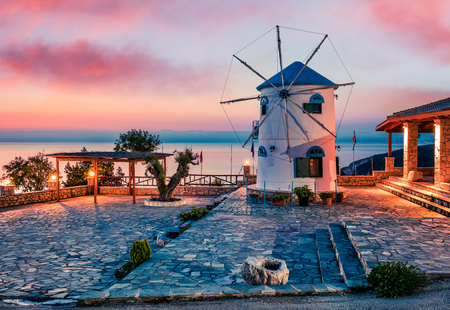 Fabulous morning scene on the Windmill. Colorful spring sunrise on the Zakynthos island, Korithi location, Ionian Sea, Greece, Europe.