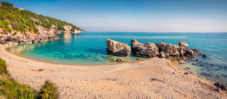 Sunny spring panorama of the Little Xigia beach. Beautiful morning view of Ionian Sea, Zakynthos island, Greece, Europe. Stock Photo