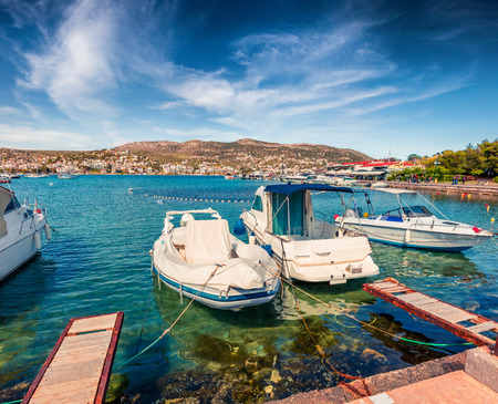 Colorful spring scene of the Porto Rafti port. Sunny morning seascape of Aegean sea, Greece. Traveling concept background.