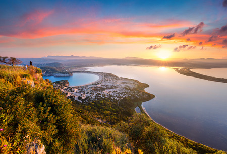 Colorful spring view of the Voidokilia beach from Navarino Castle. Great sunrise on the Ionian Sea, Pylos town location, Peloponnese, Greece, Europe. Stockfoto