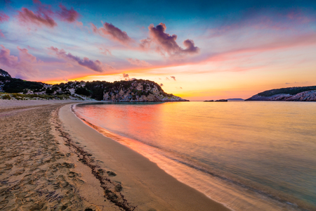 Colorful spring sunrise on Voidokilia beach. Dramatic morning scene of the Ionian Sea, Pilos town location, Greece, Europe.