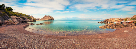 Impressive spring panorama on the cozy beach in northeastern Corinthia, Greece. Sunny outdoor scene of the Greek resort.
