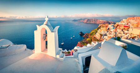 Sunny morning panorama of Santorini island. Picturesque spring sunrise on the famous Greek resort Fira, Greece, Europe.