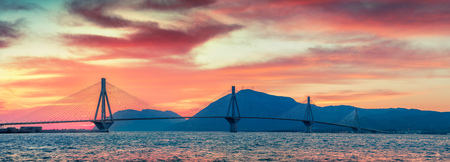 Dramatic evening sunset with Rion-Antirion Bridge. Colorful spring panorama of the Gulf of Corinth, Greece, Europe. Stock Photo