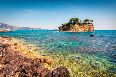 Sunny spring view of the Cameo Island. Picturesque morning scene in the Port Sostis, Zakynthos (Zante) island, Greece, Europe. Stock Photo